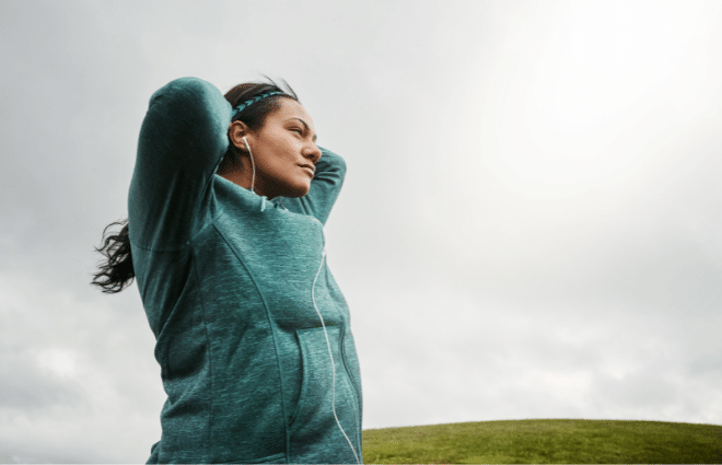 Woman focusing mentally while running a race
