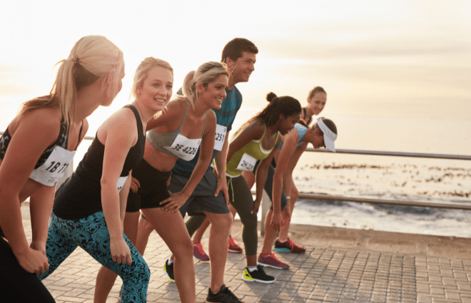 Runners at the starting line of a race on the beach